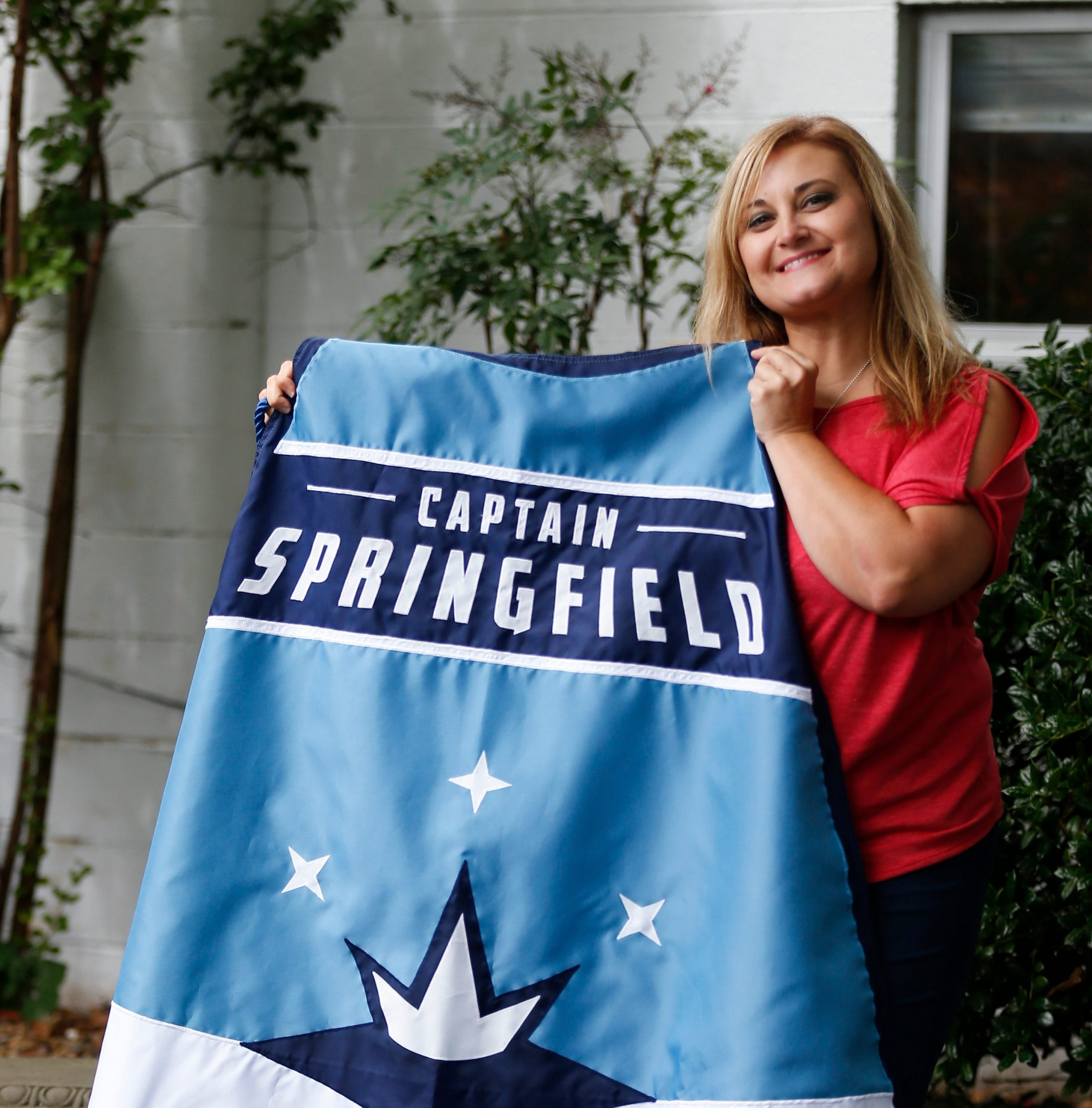 Janelle Reed, the outreach and special events manager for Victory Mission, was presented a cape after being named the third Captain Springfield.