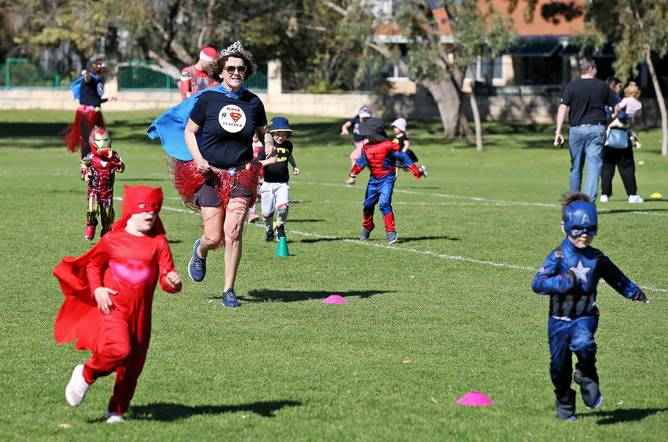 Teacher Alison Ford runs with the children.