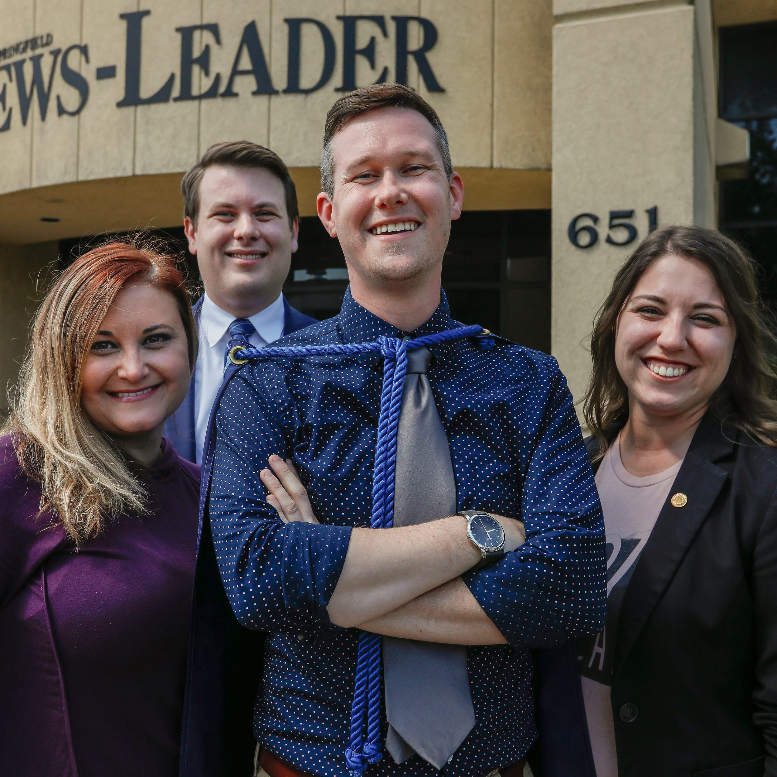 Three former Captain Springfields gathered to pass the cape onto Michael Underlin, center, at the Springfield News-Leader on Tuesday, Sept. 3, 2019. From left are Janelle Reed, Matthew Simpson, Underlin and Crystal Quade.