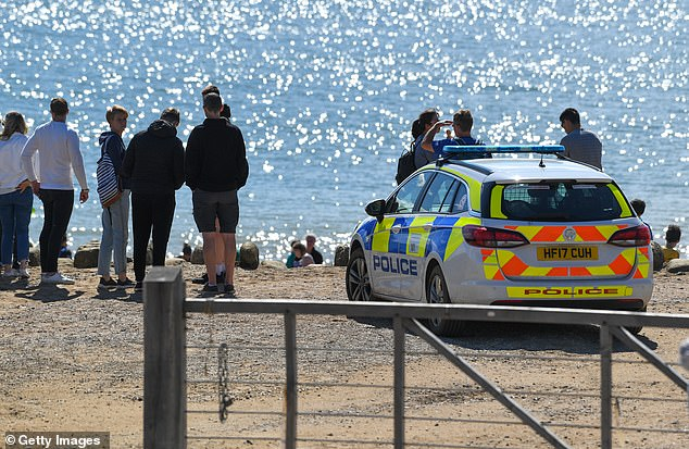 Police at the scene of the 9,000 ton cliff fall on August 29, 2020 in Burton Bradstock, Dorset, England