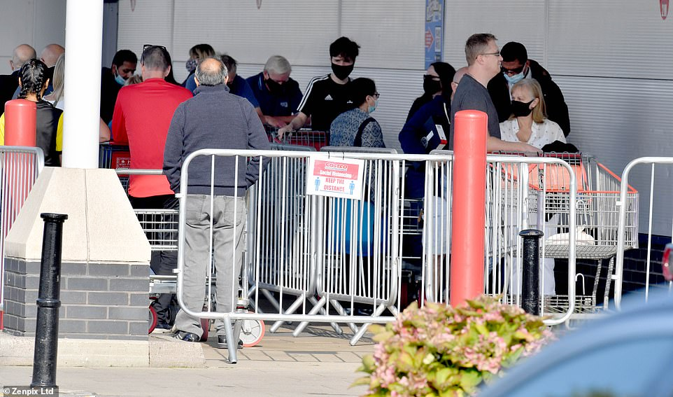The queues come after Chief Scientific Adviser Sir Patrick Vallance said yesterday the UK could hit 50,000 cases a day by mid-October and 200 plus daily deaths by November unless Britain changes course (pictured, Costco Chingford)