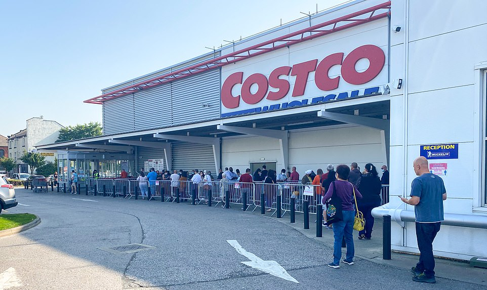 Costco wholesale stores across the UK saw a surge in shoppers today, leading to long queues (pictured: Costco store, Leeds)
