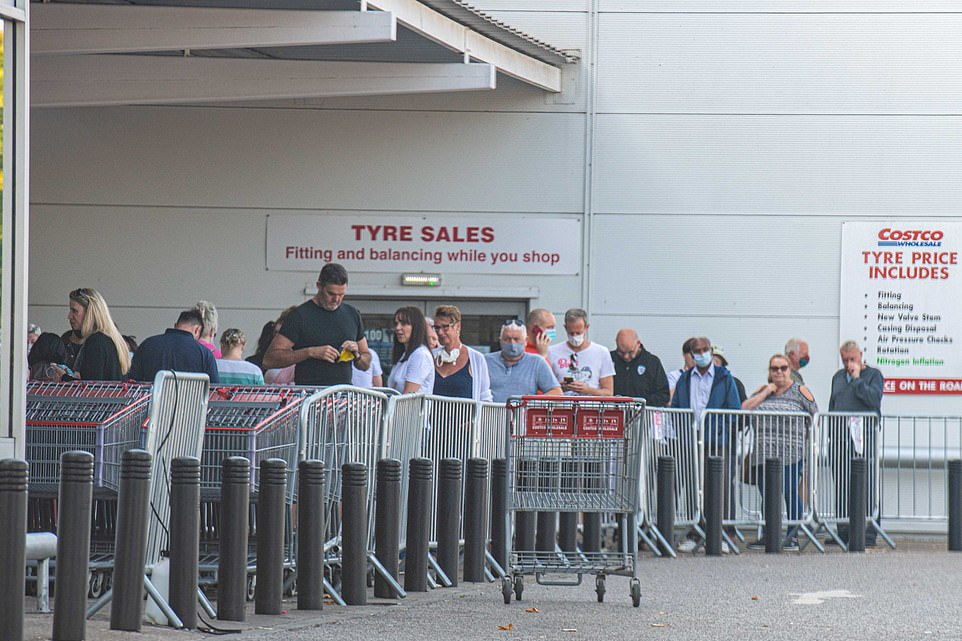 Crowds gathered as people queued to get into the large wholesale stores. Here cutomers at Costco in Leeds wait for entry