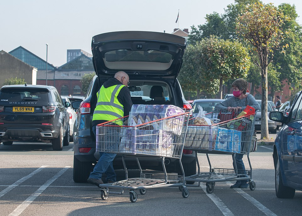 Two trollies were needed to carry this shoppers purchases as they were seen loading it in to the back of their car in Leeds