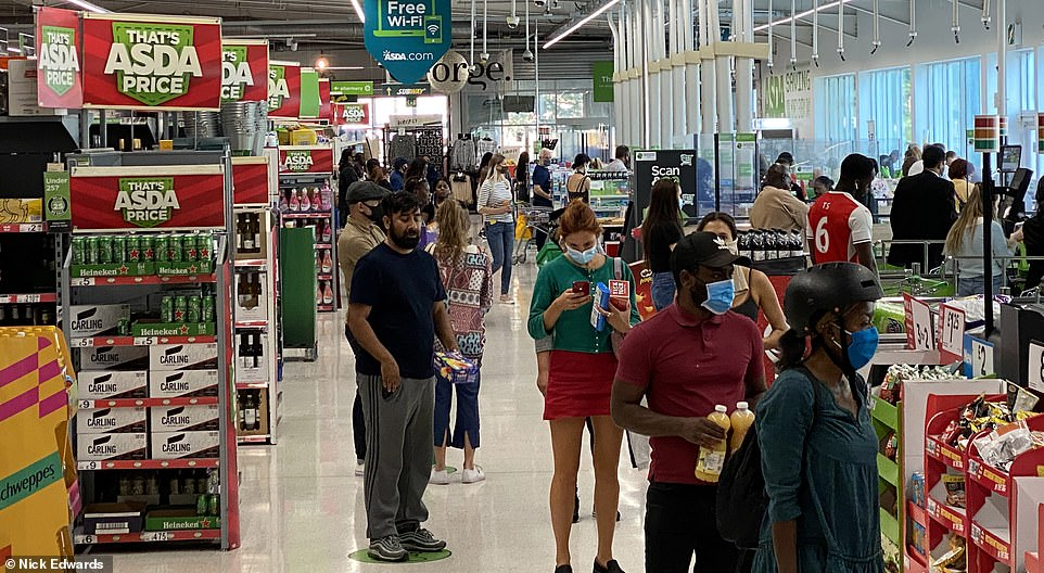 Buyers rush to an Asda supermarket in South London as the Government issues a series of tougher measures on the country in a bid to control the spread of coronavirus