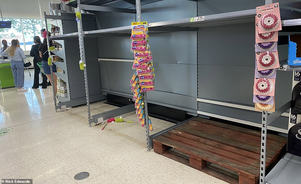 Shelves that once had toilet paper appeared empty at an Asda supermarket in South London after scores of customers once again hit the stores to panic buy